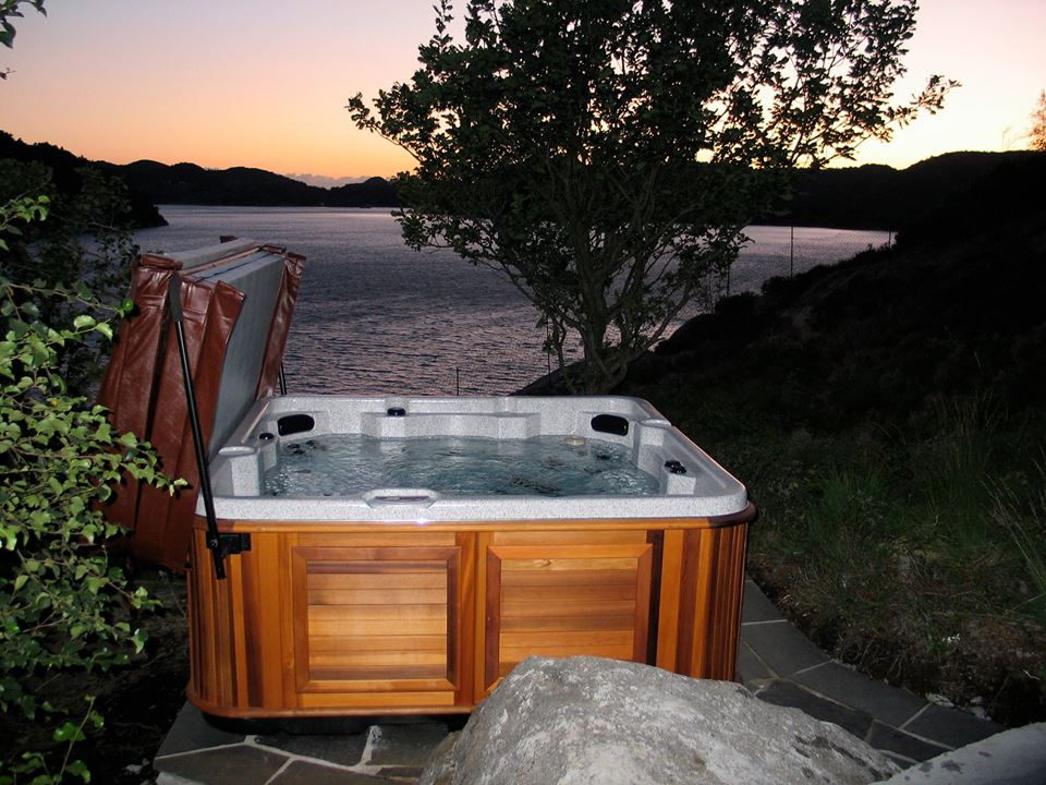This popular 7 person spa is shown with a cedar cabinet and typical cabinet mounted cover lifter.
